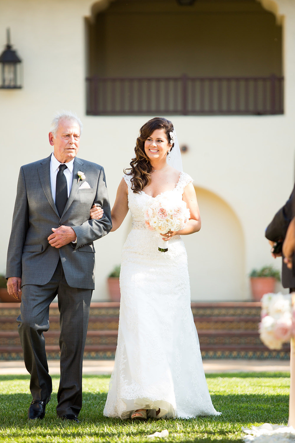 A bride and her father walk the aisle