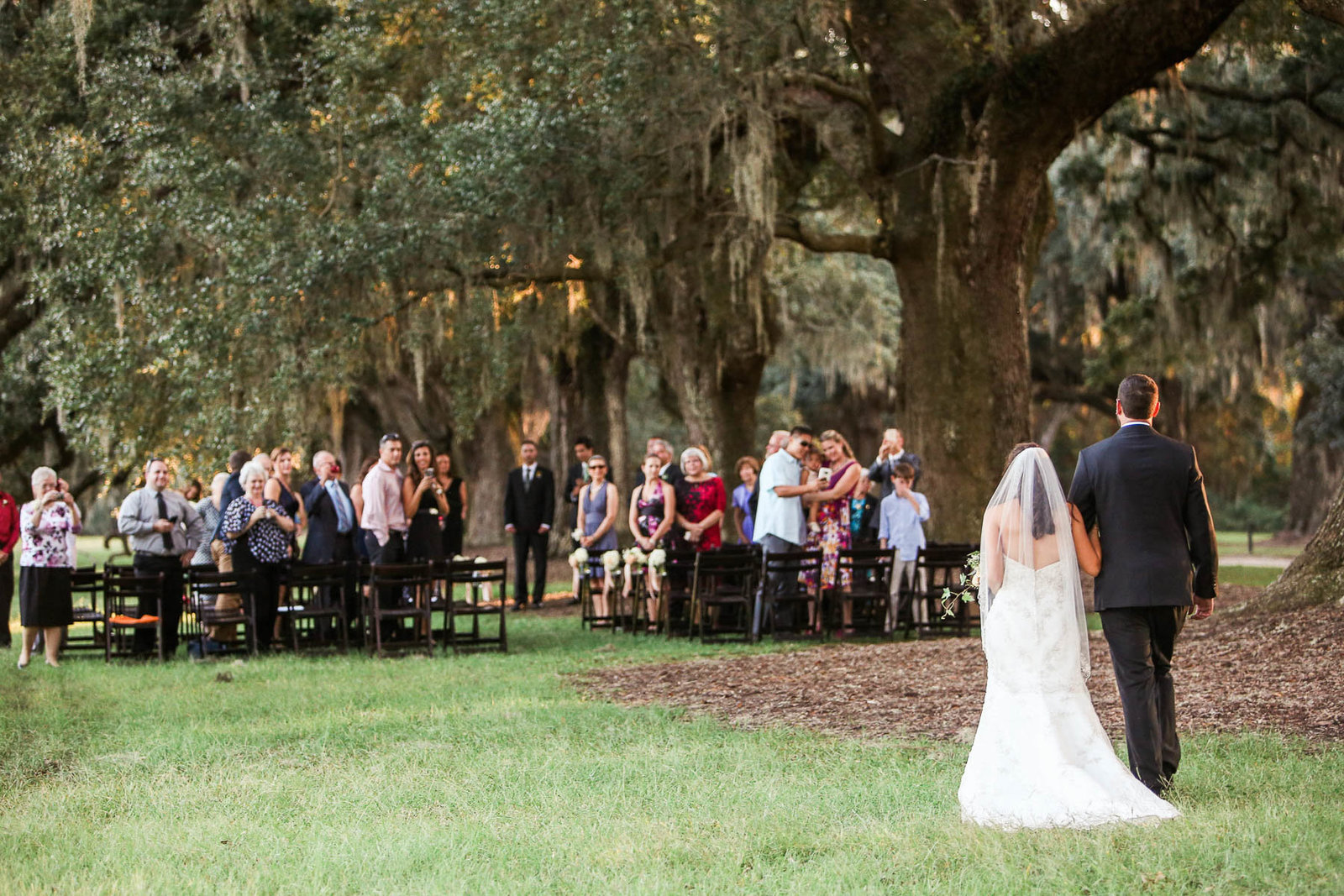 Brother walks bride down the aisle, Boone Hall Plantation, Charleston, South Carolina. Kate Timbers Photography.