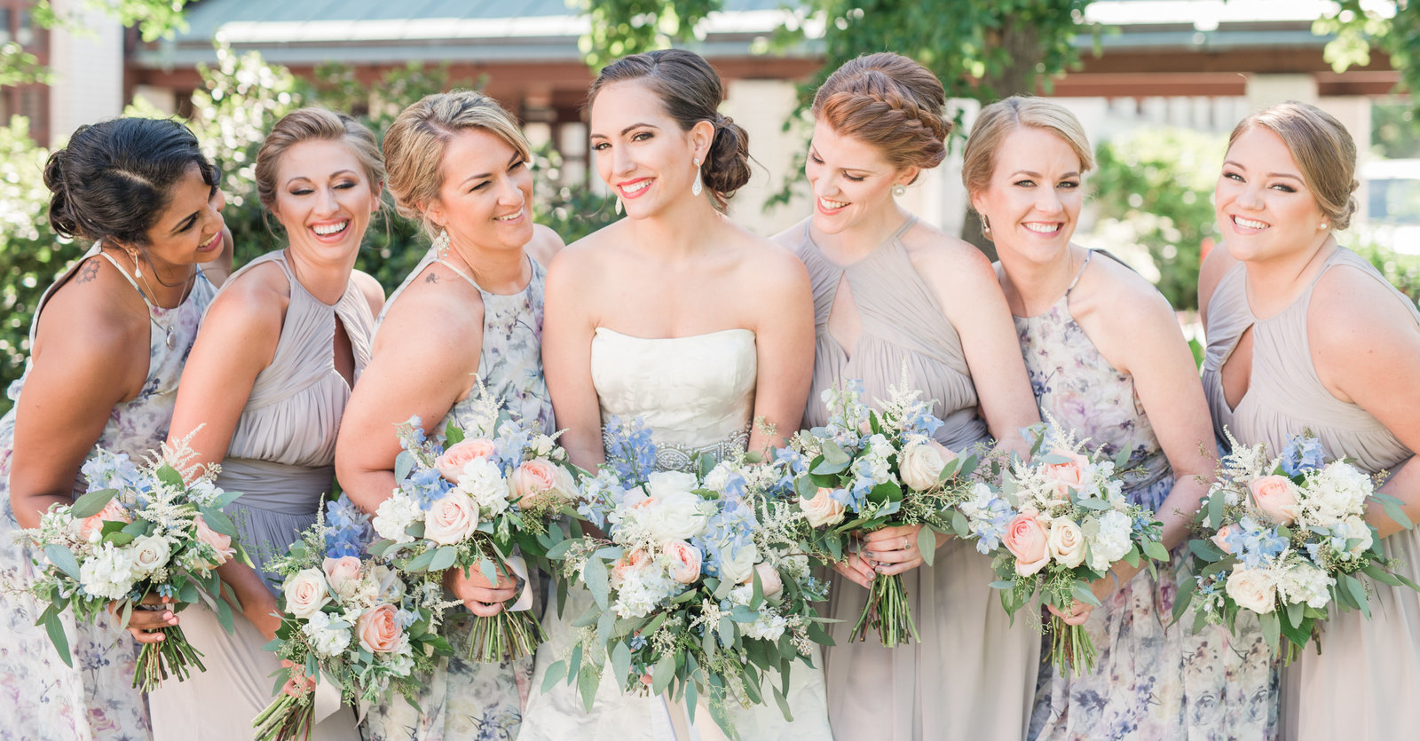 floral pastel bridesmaids dresses at virginia beach moca by norfolk wedding photographer
