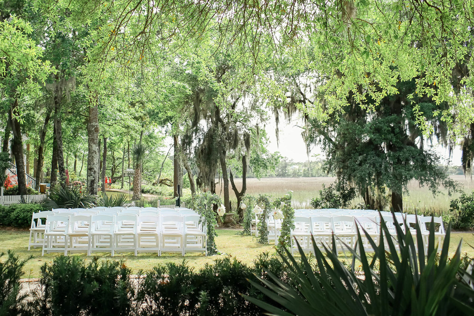 Vine and white flowers adorn the aisle, I'ON Creek Club, Charleston Wedding Photography.