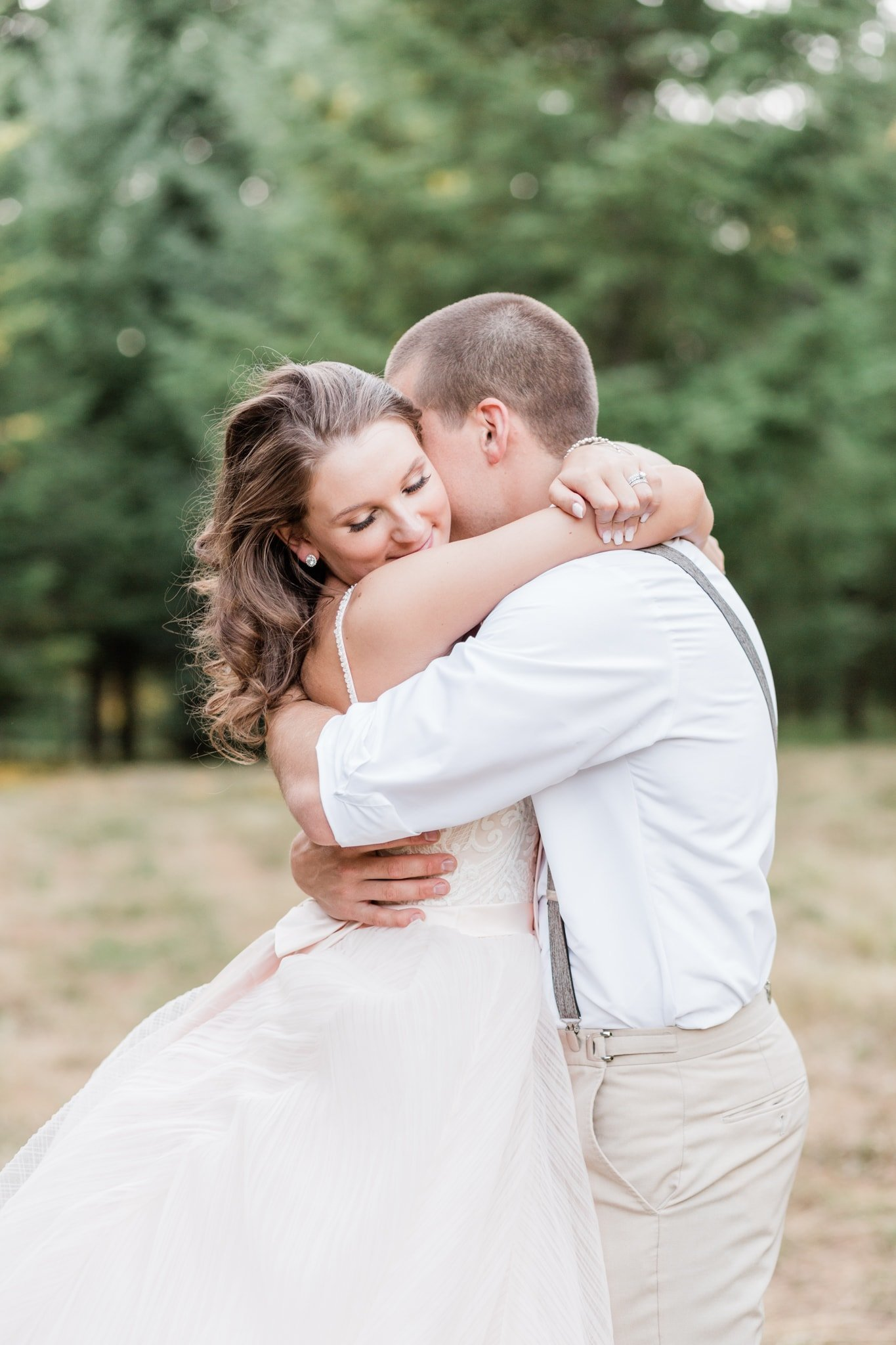 Bride and Groom hug during sunset photos