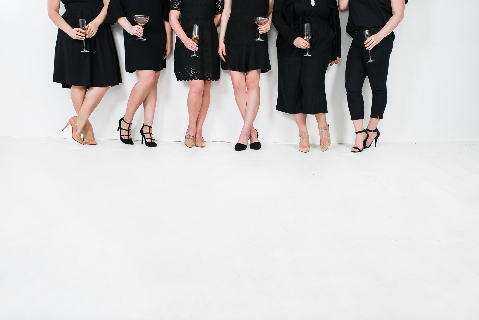Branding photo shoot of ladies in little black dresses with great heels