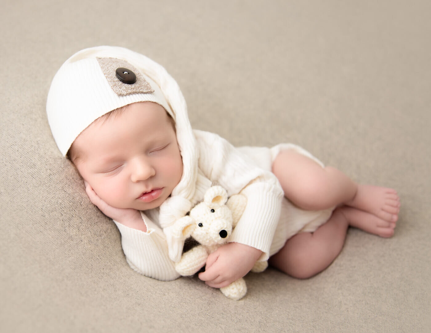 Posed newborn boy at our in-home Rochester, Ny studio.