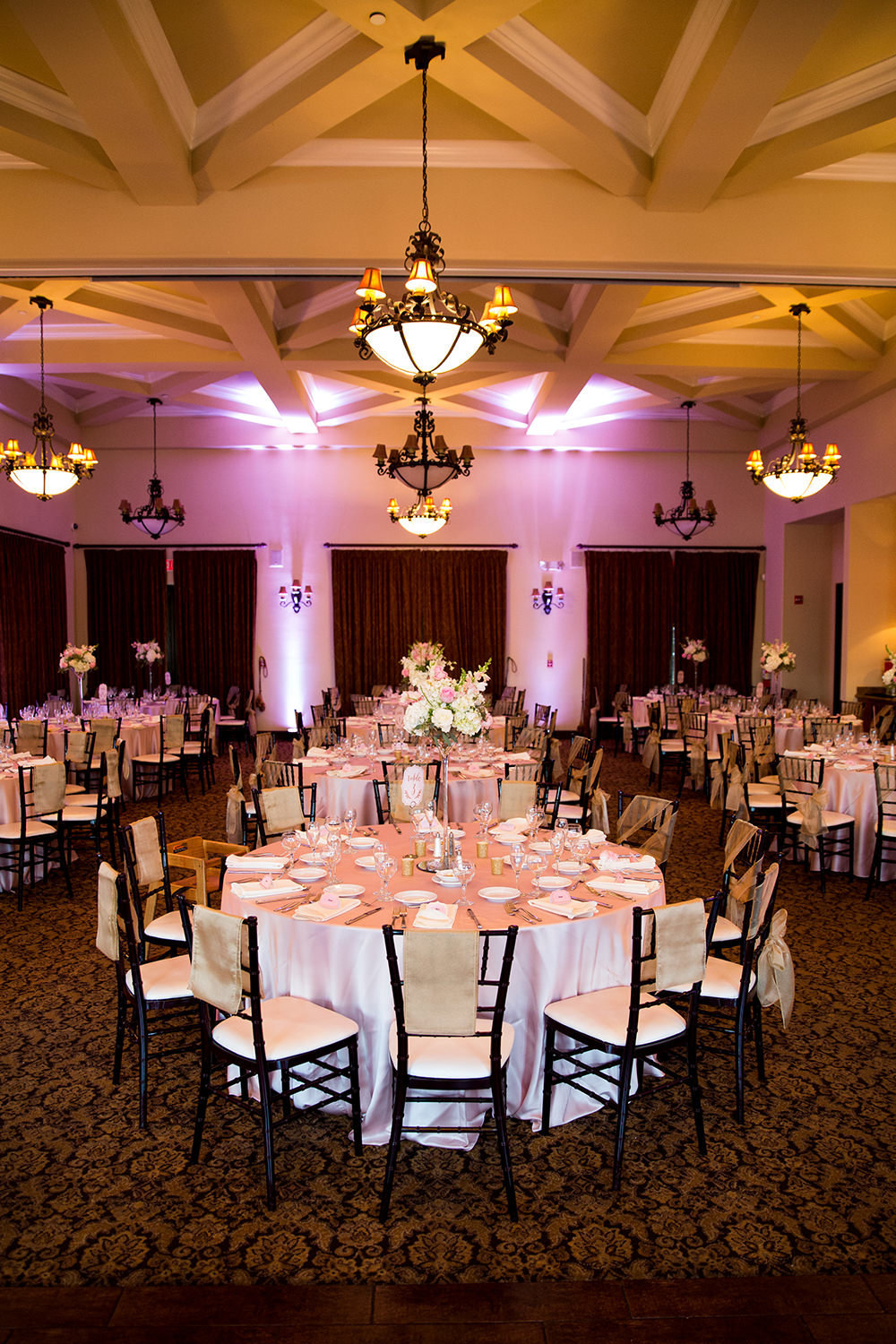 reception space at wedgewood purple pink uplighting
