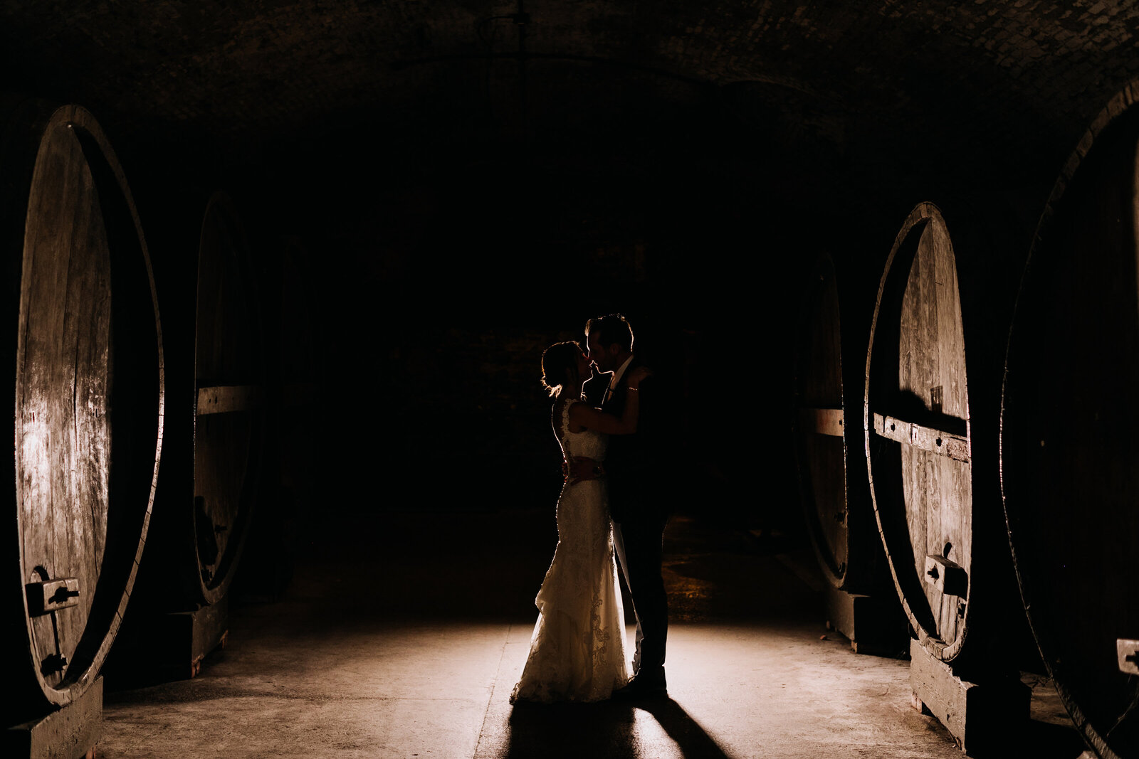 bride and groom wine barrels