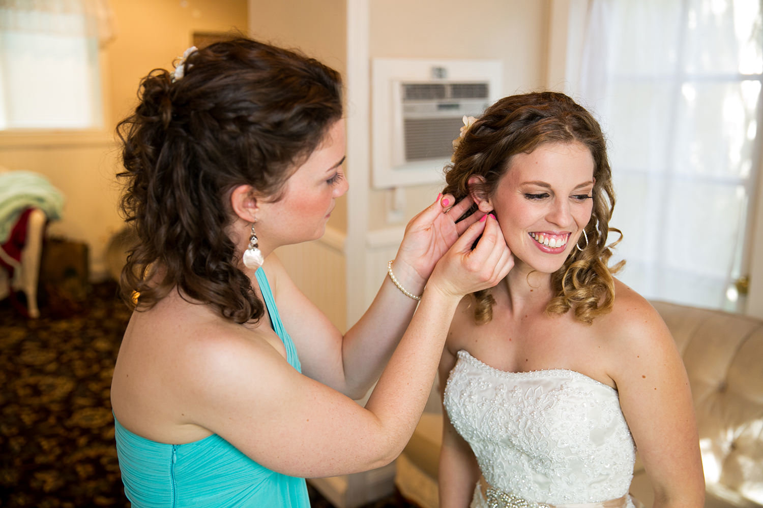 bride getting ready with earrings