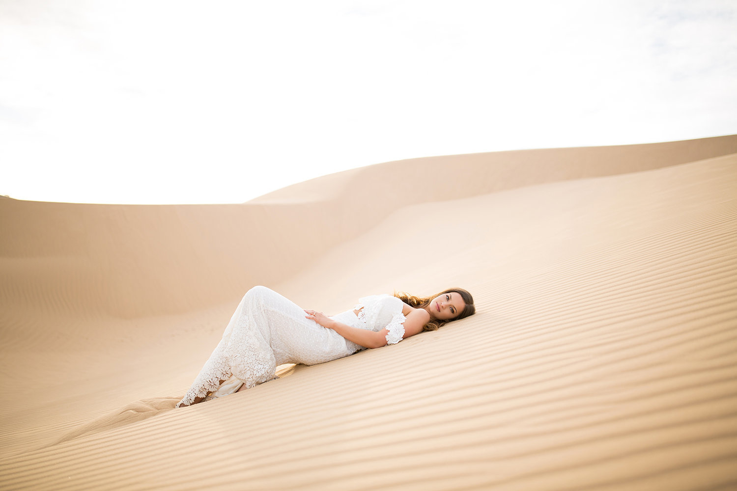 Lovely Bride Laying Down on Glamis Sand Dune During her Wedding