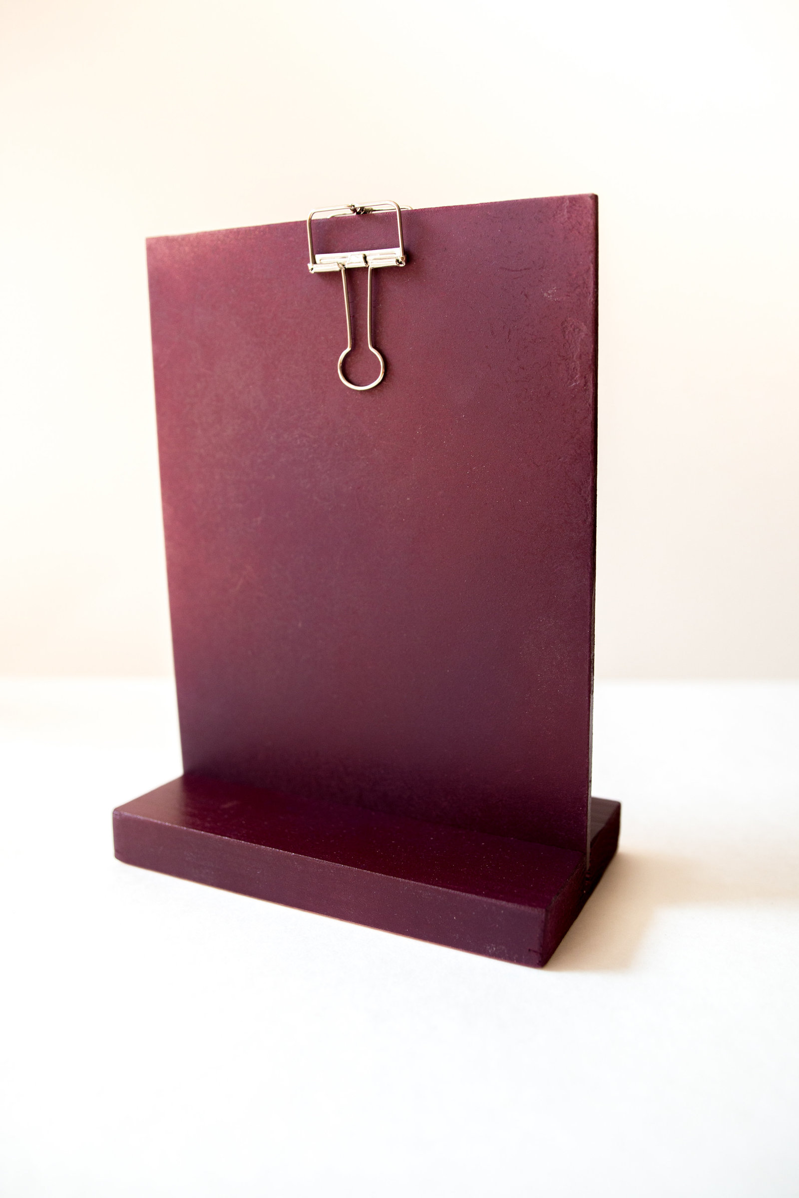 Mauve self standing wood clipboard for signs at weddings or events through Hue + FA rentals