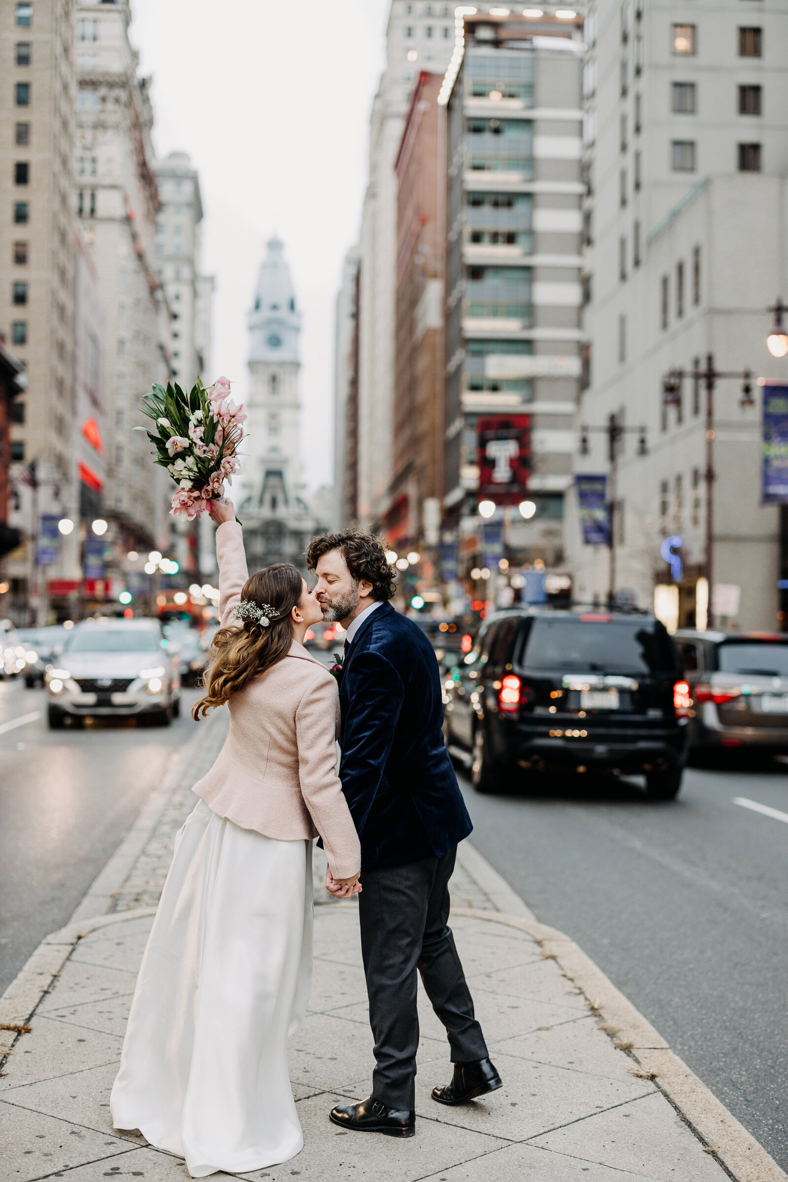 bride and groom kissing broad street