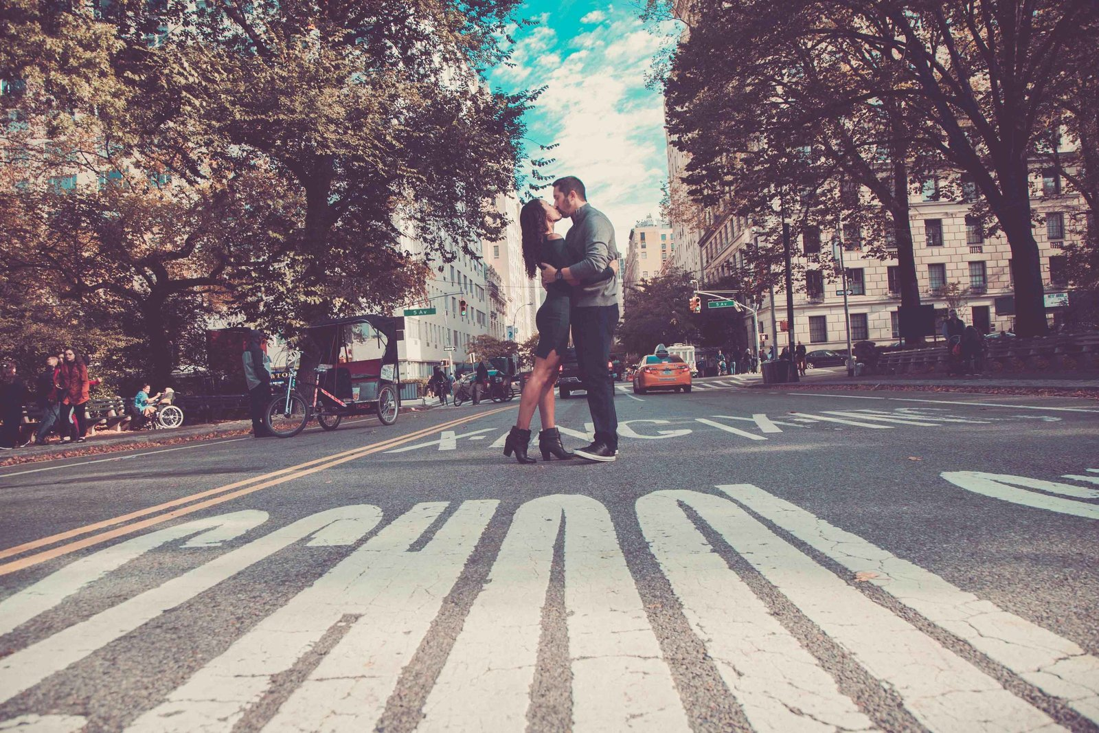 Wide angle of couple in middle of NYC street.