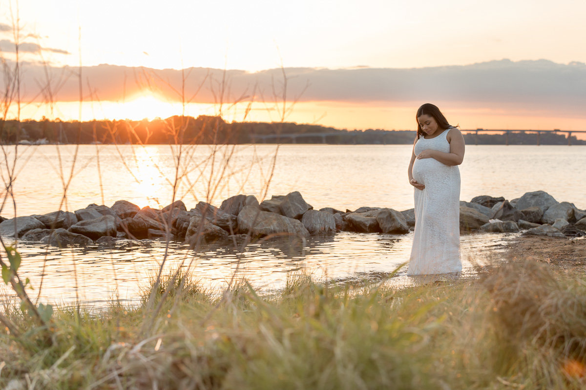 rocks-sunset-pregnant-woman-standing-in-water