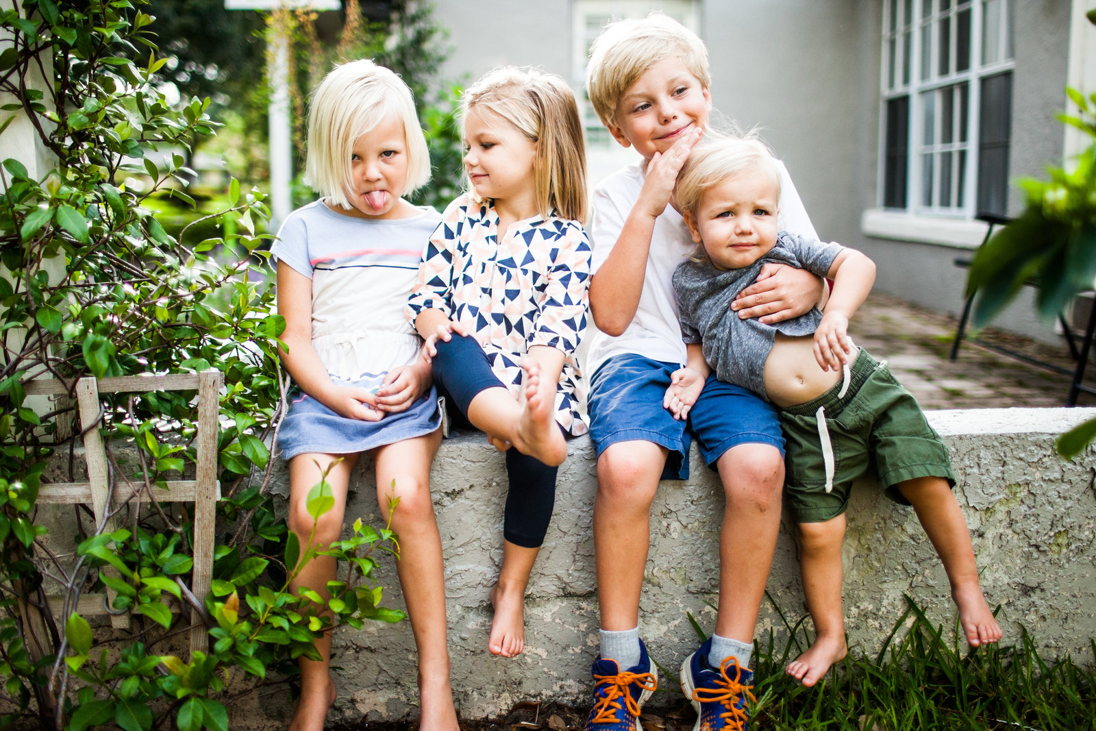 Silly and authentic family portraits of four kids