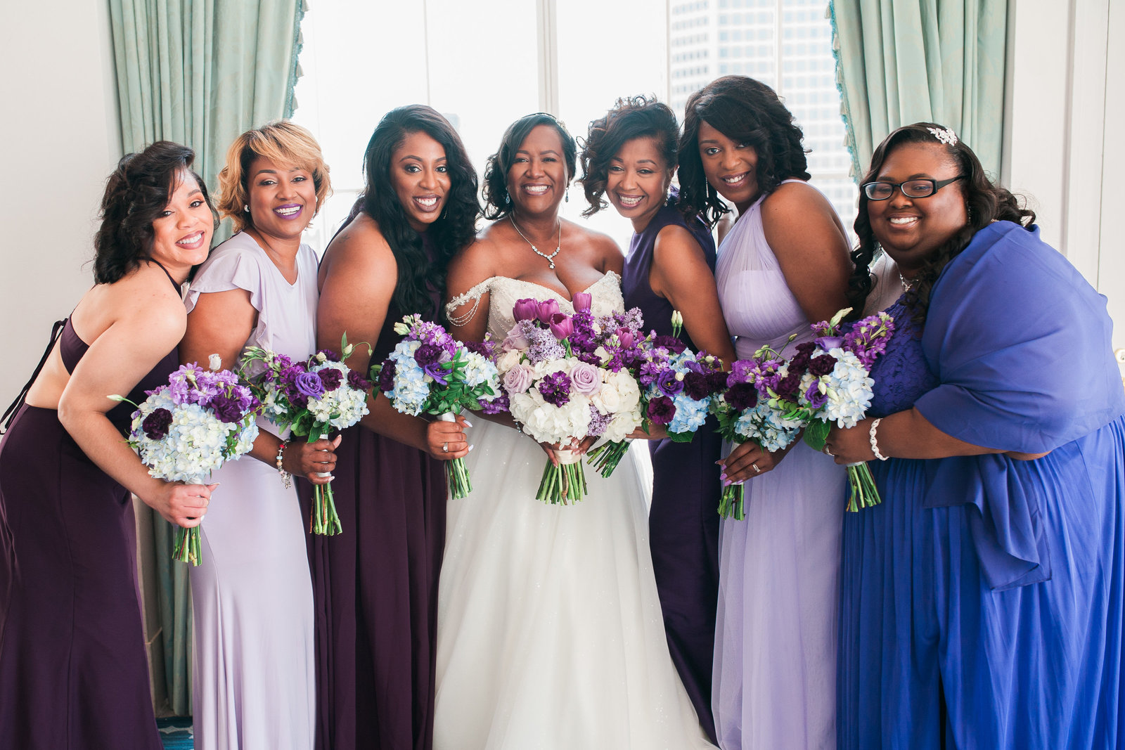 bride posing with bridesmaids in purple dresses St Louis Pinxit Photo