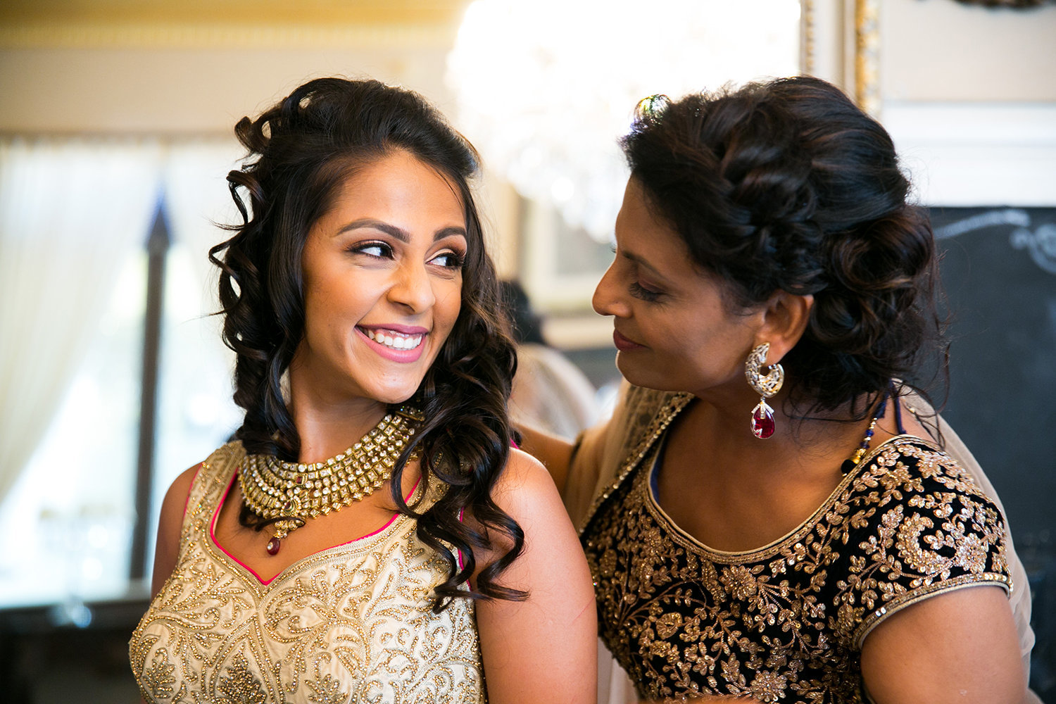 Sweet moment between mother and daughter before Hindu Indian wedding ceremony