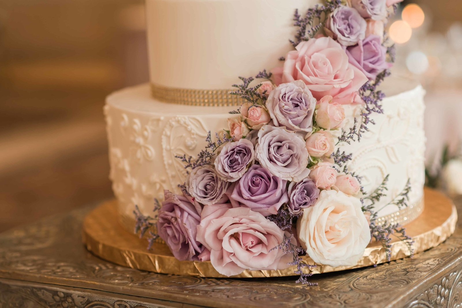 Elegant wedding cake with Pink and Purple flowers.
