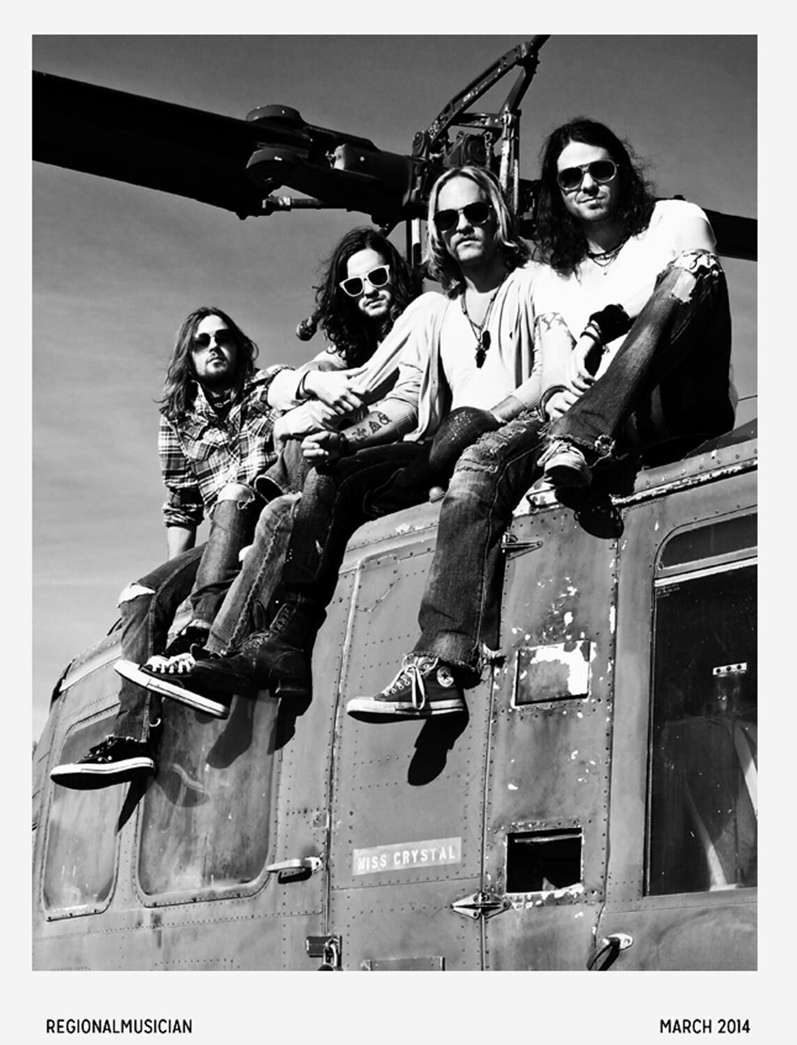 Photographer Interview Mark Maryanovich Regional Musician Magazine black and white band portrait four members sitting on top of helicopter page 5