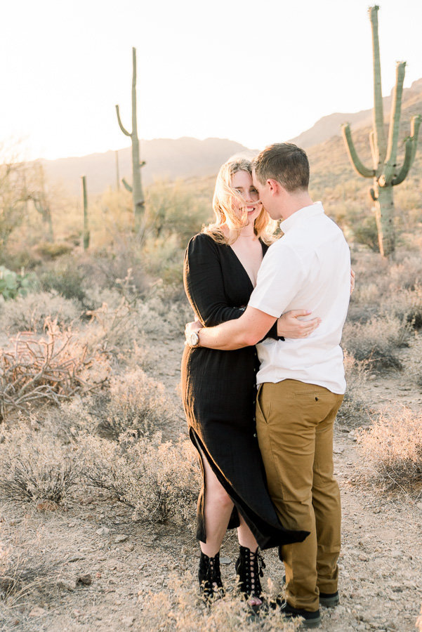 Tucson Sanctuary Cove Engagement Session Photo of Couple Amongst the Saguaro Cactus | Tucson Wedding Photographer | West End Photography