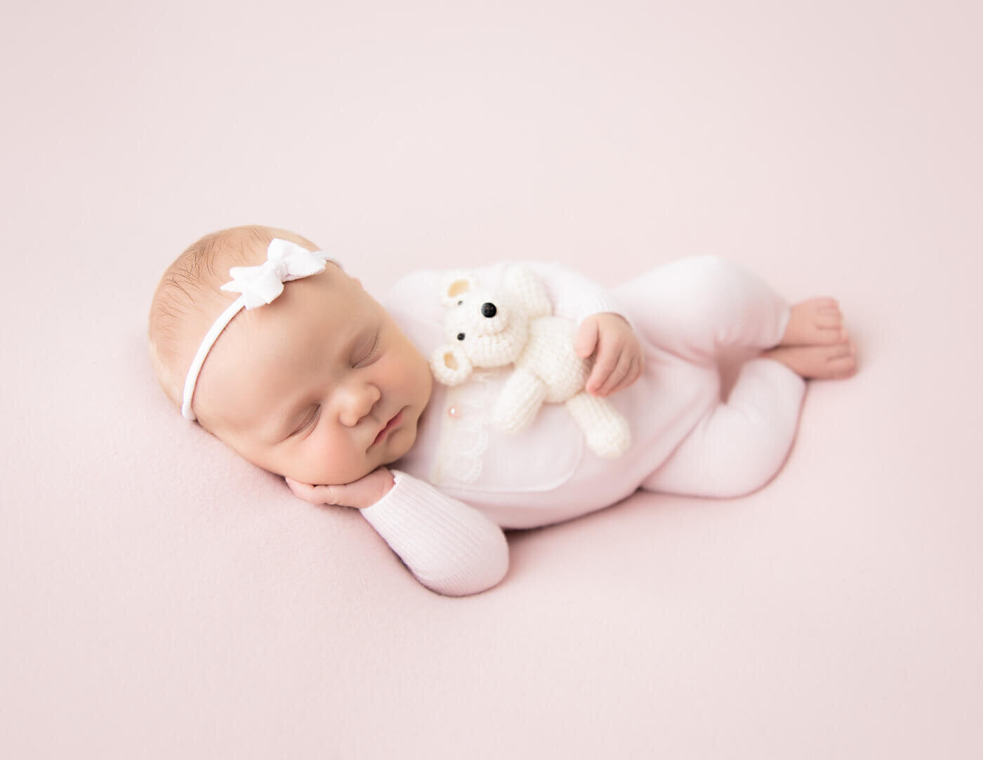 Precious newborn girl posed in Rochester, NY in our studio.