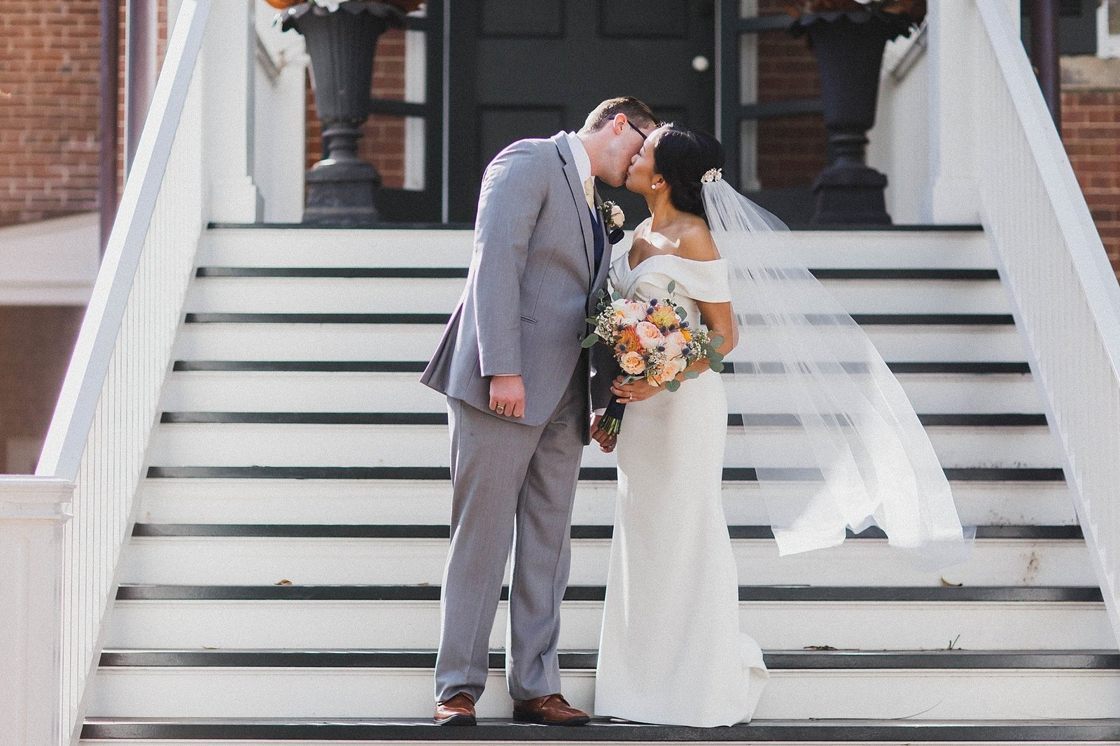 M Harris Studios_Braehead Manor_VA Wedding Photographer_bride groom kiss on stairs