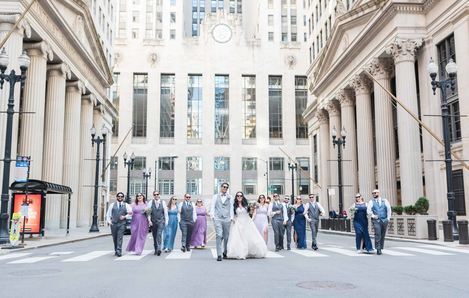 Wedding party strolling down by the Chicago Board of Trade.