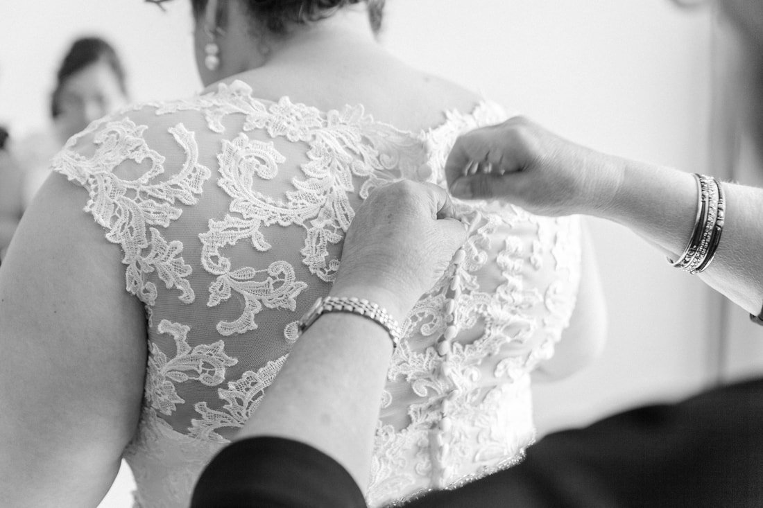 Putting on a lace wedding gown at Marquette's Holiday Inn