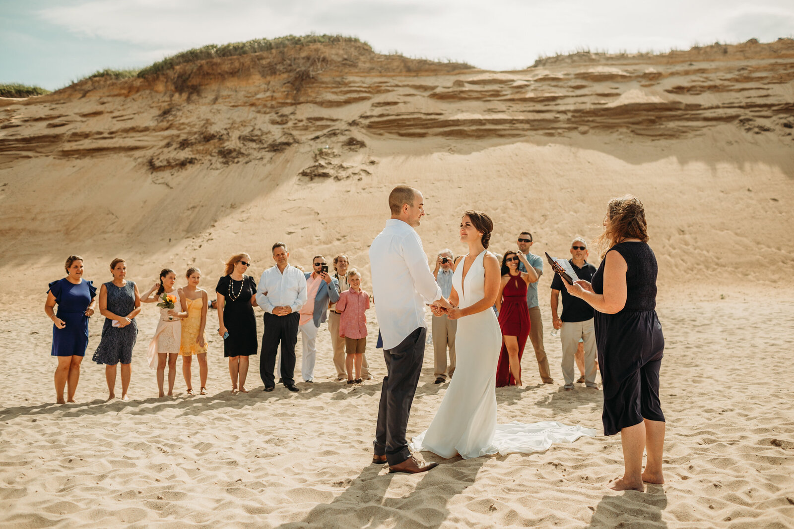 couple elopes on a beach in massachusetts with friends