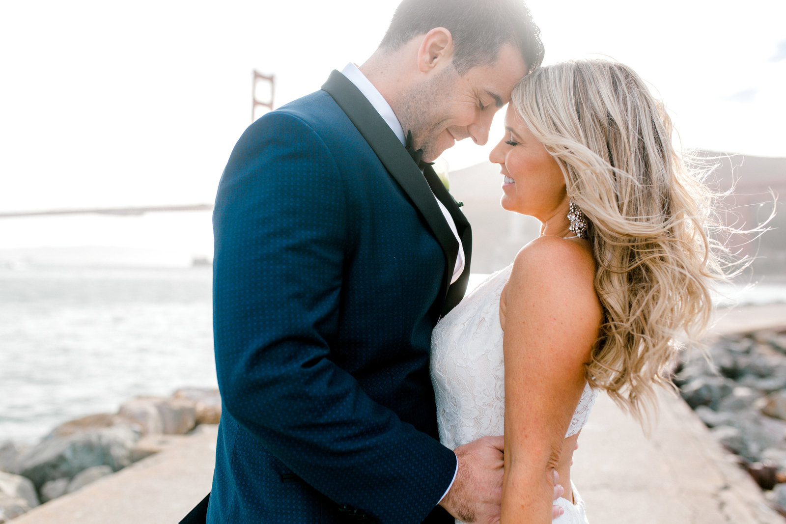 bride and groom Presidio Yacht Club with Golden Gate Bridge