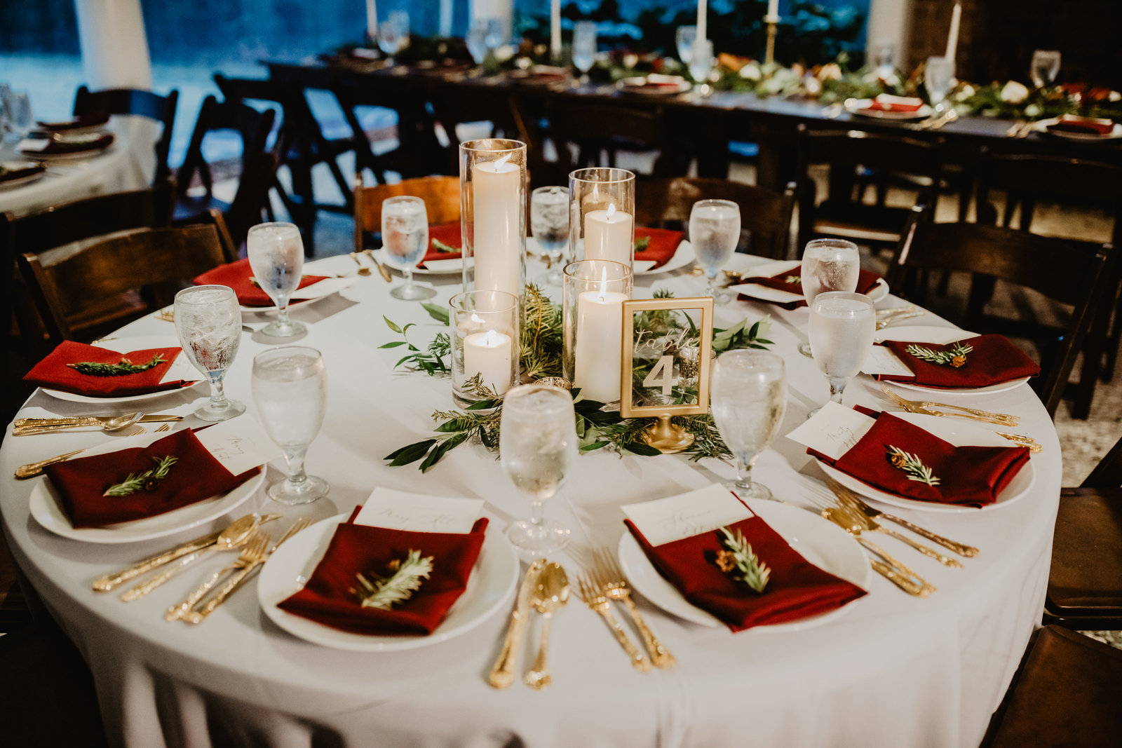 Winter accented table with burgundy accents and touches of greens at the Mackey House