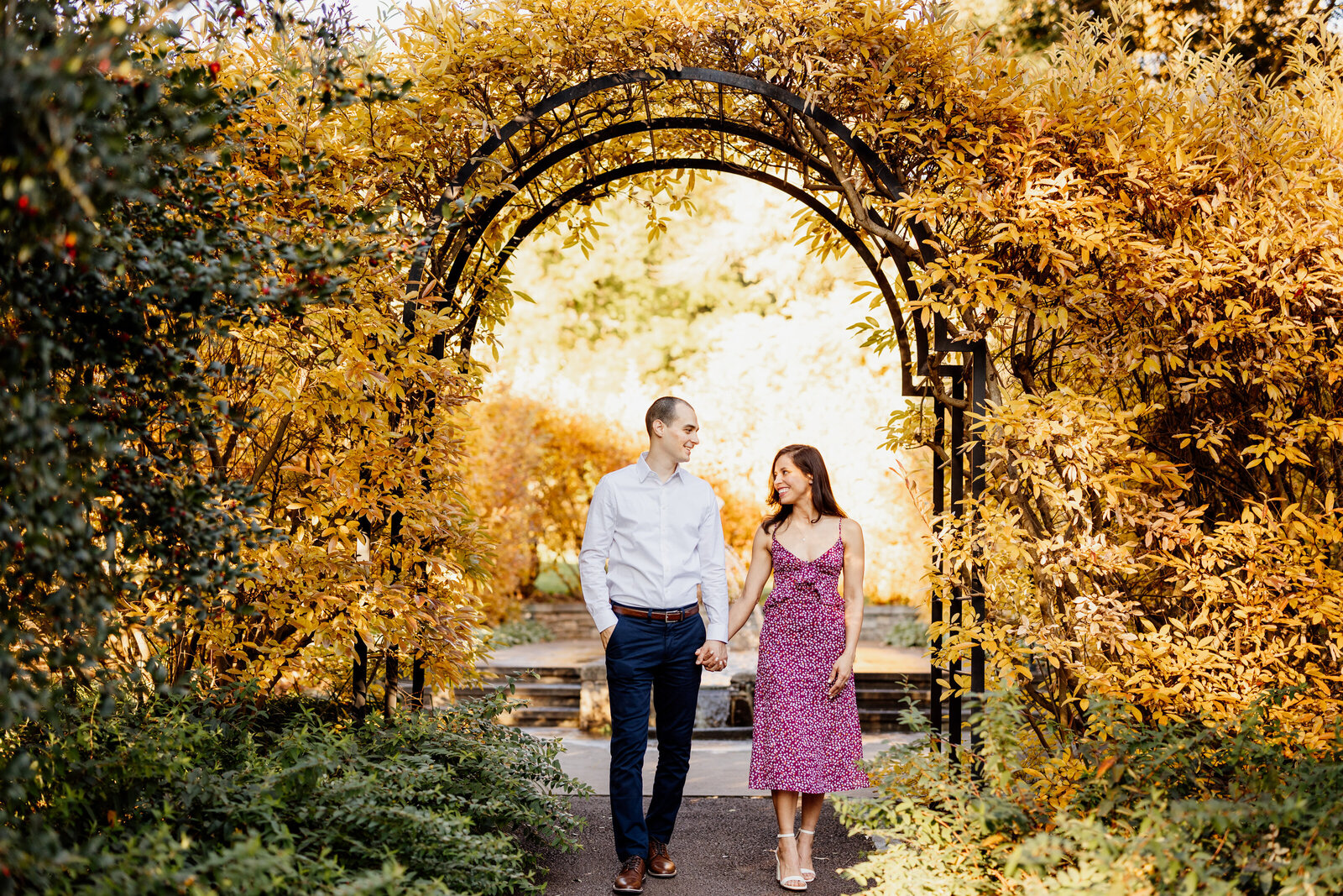 engaged couple flower garden