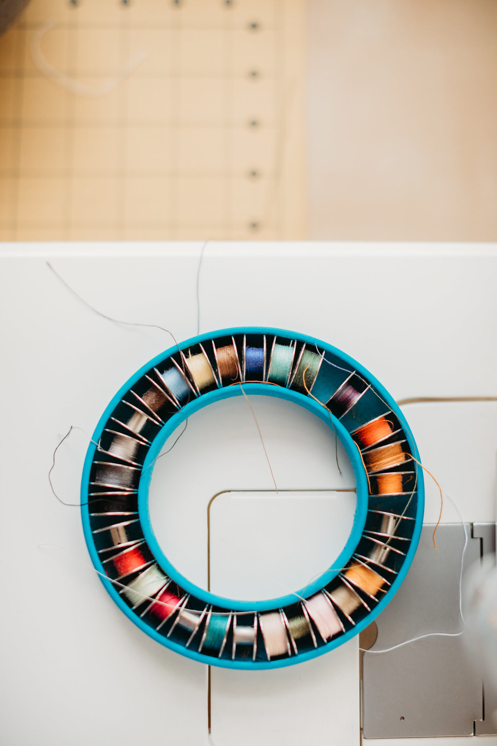 spool of colorful thread on a sewing machine in a boston studio