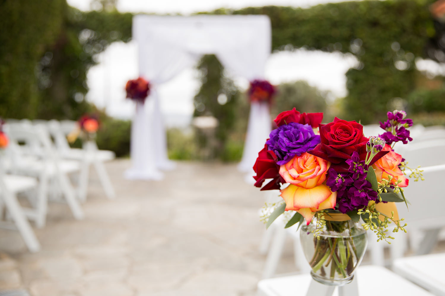 beautiful ceremony flowers purple and yellows