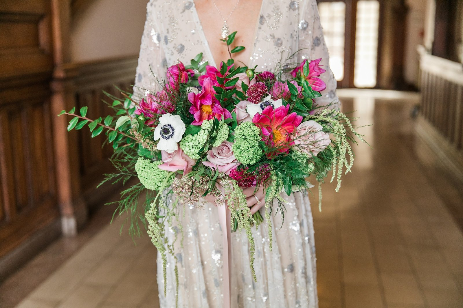 beaded-wedding-dress-vibrant-floral-bouquet
