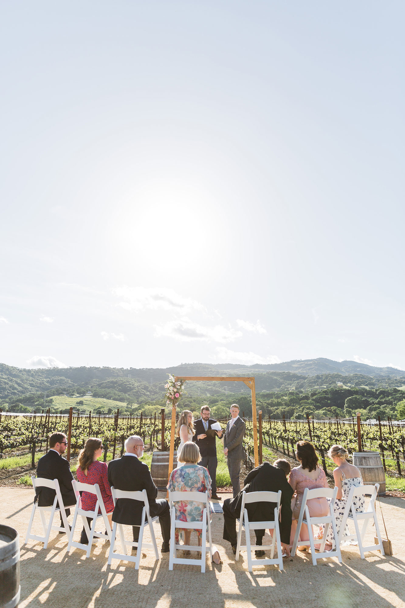 intimate wedding ceremony held at the vezer family vineyard's blue victorian