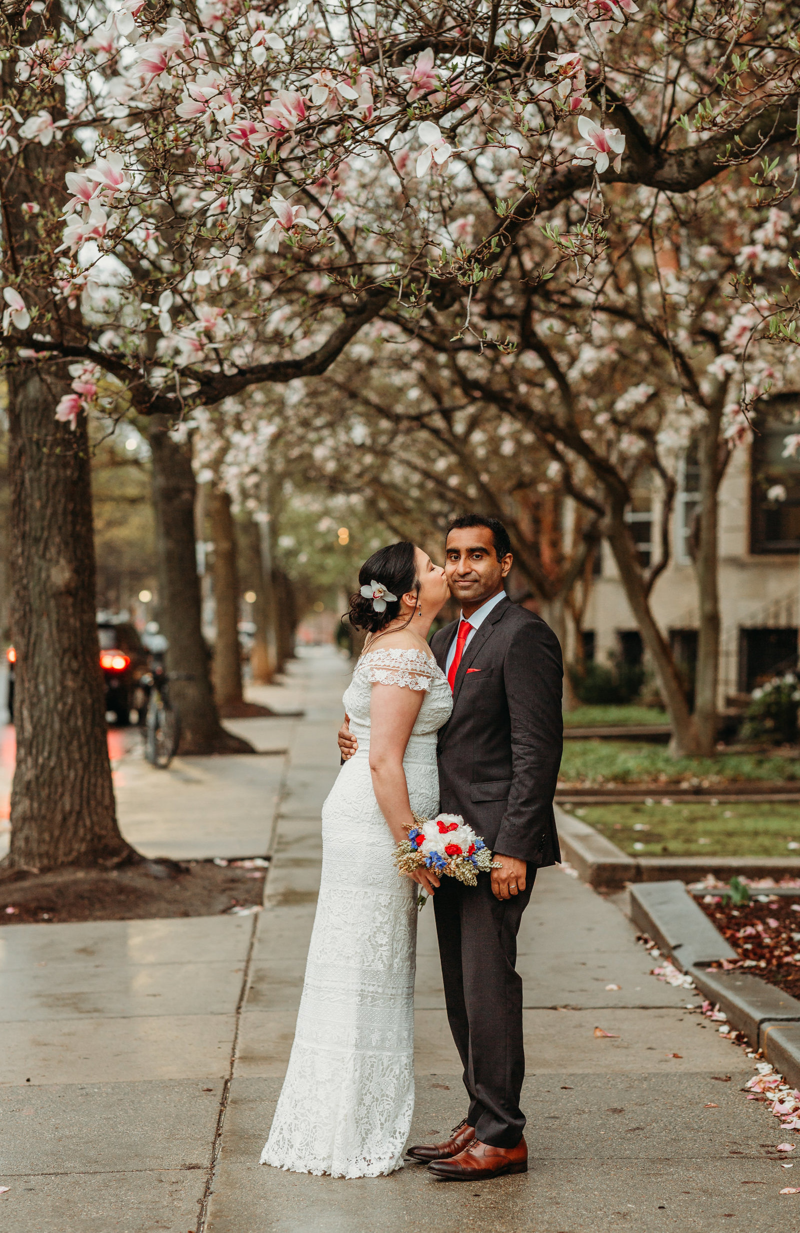 spring elopement under cherry blossoms