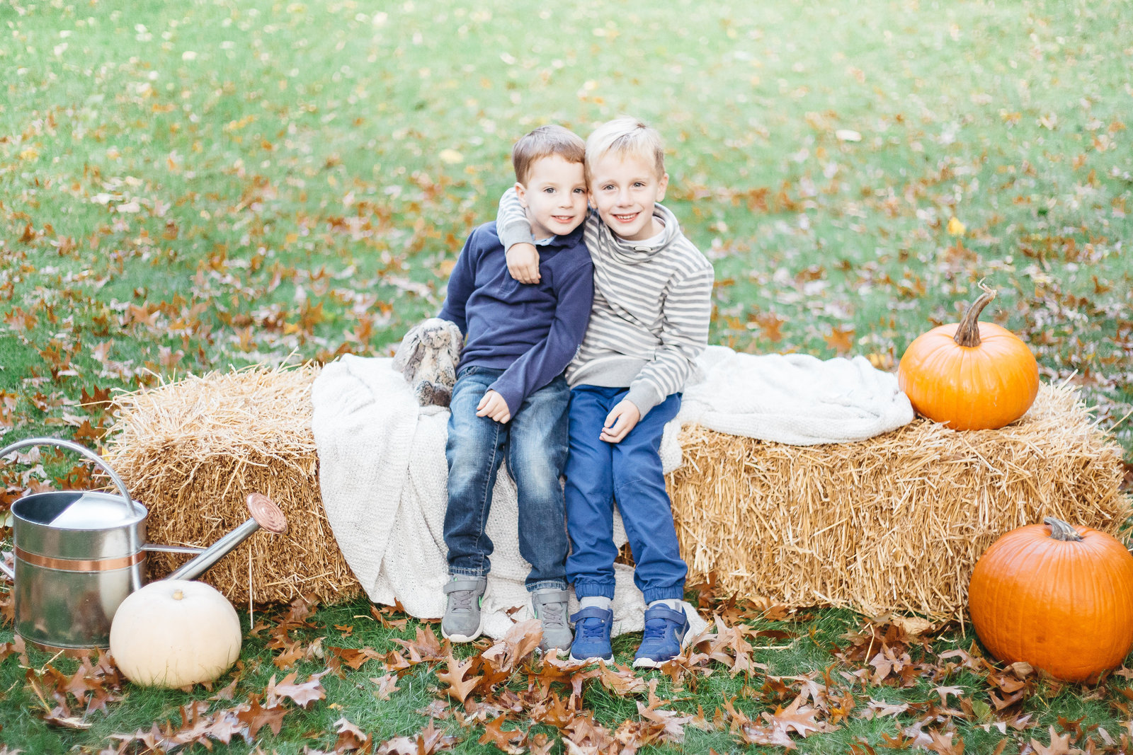 Rochester NY family photography session showing two brothers hugging