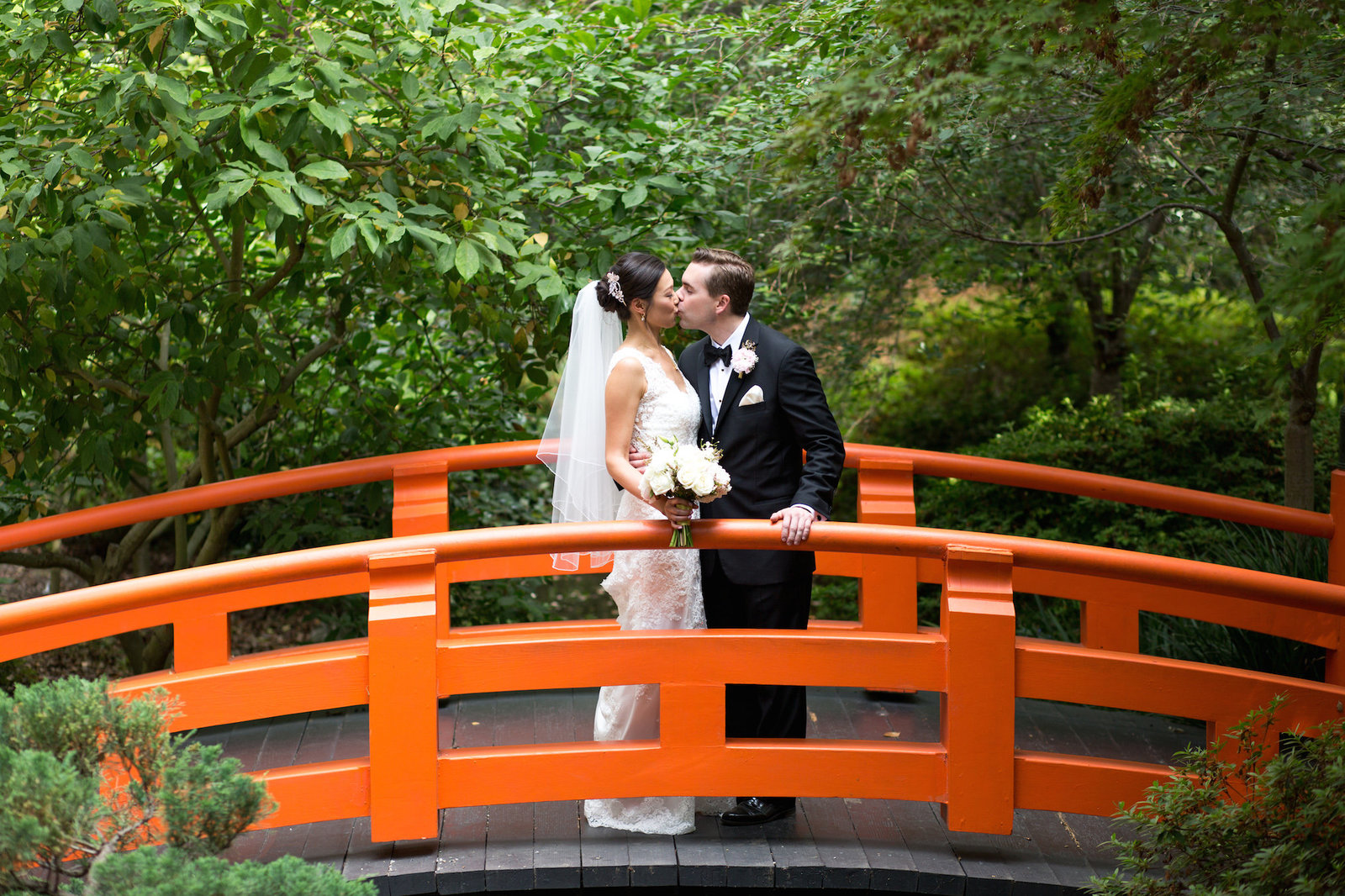 bride and groom together in decanso gardens in los angeles