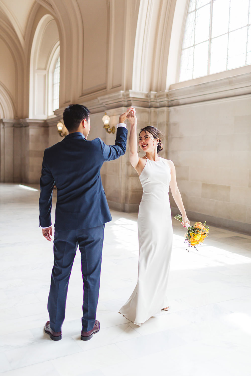 dancing twirling bride and groom celebrating their san francisco city hall wedding