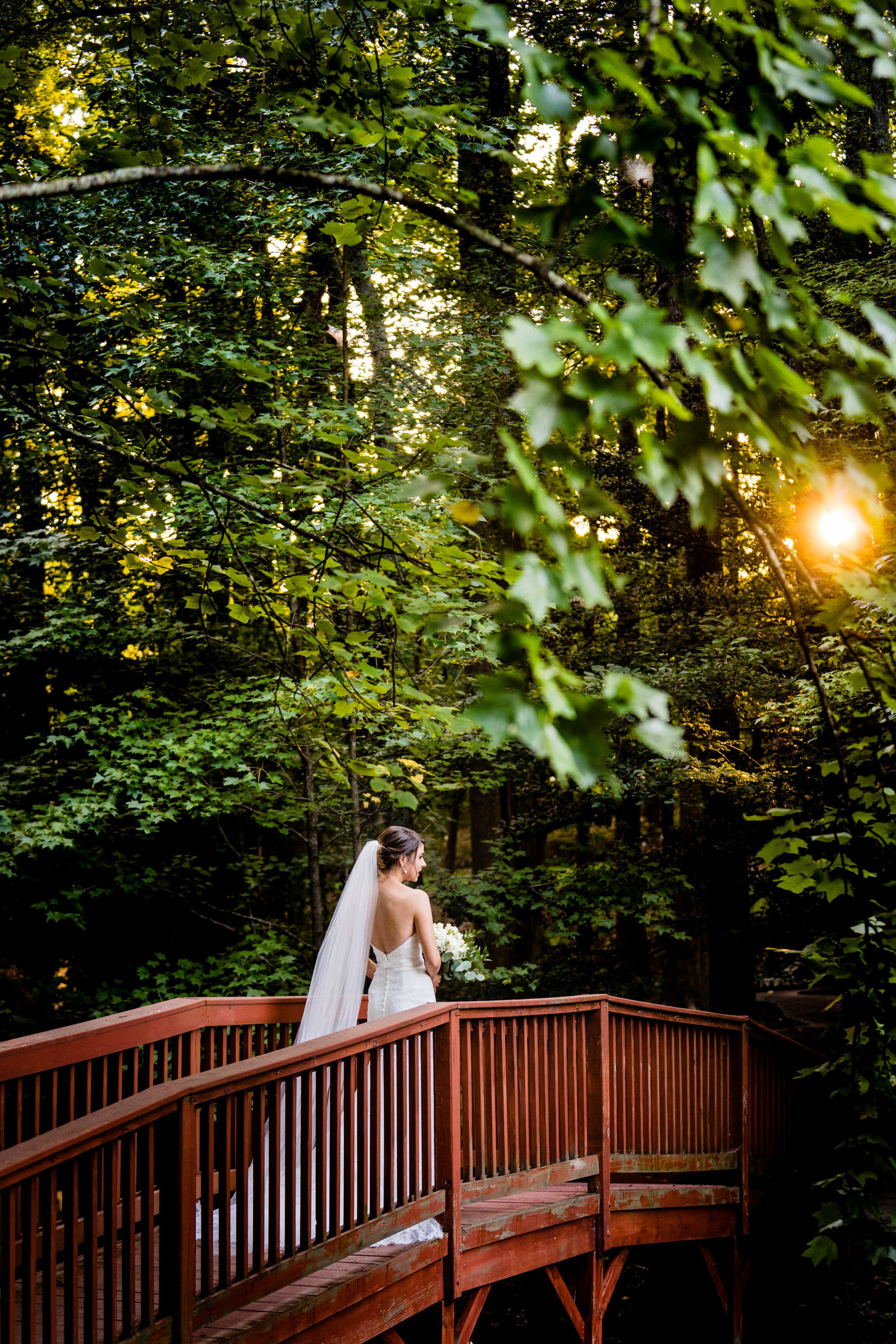 bride walking over red bridge