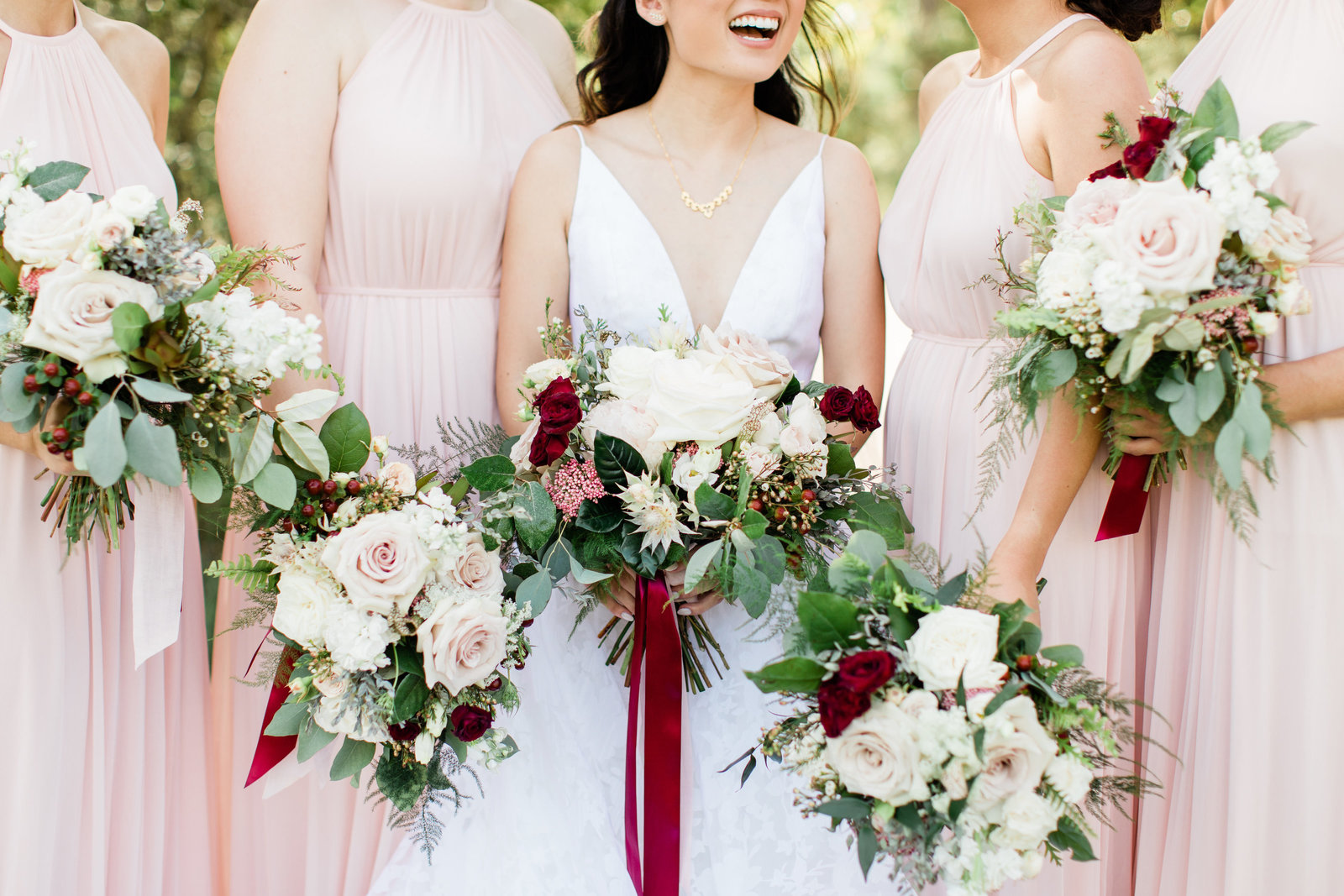 Beautiful pink bridesmaid bouquets and dresses at Peach Creek Ranch in College Station