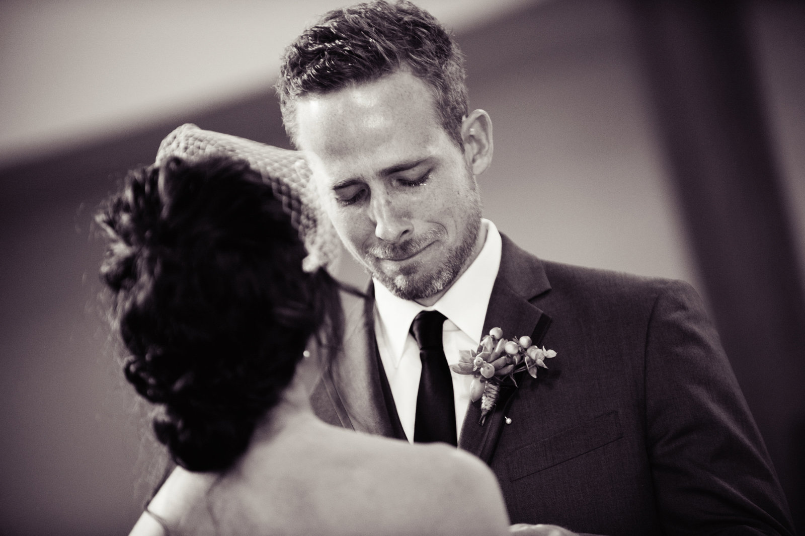 emotional groom reads his vows