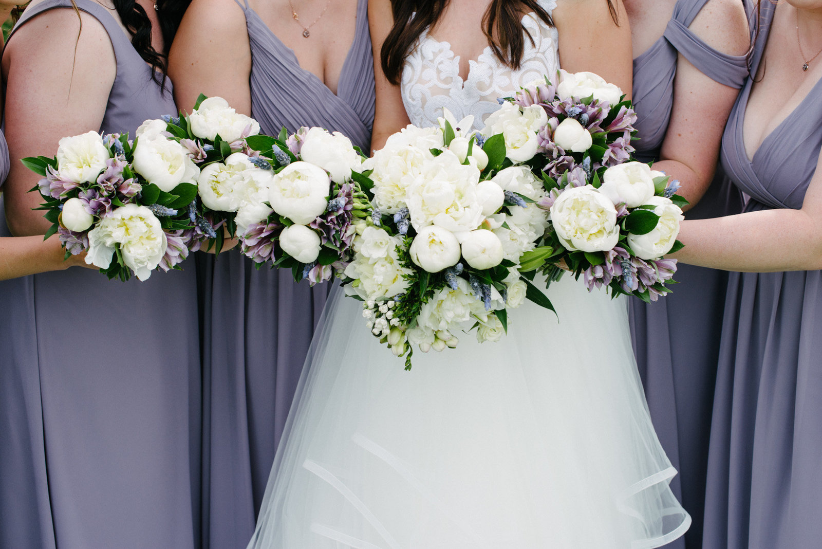 bridesmaids with flowers in lavender and white