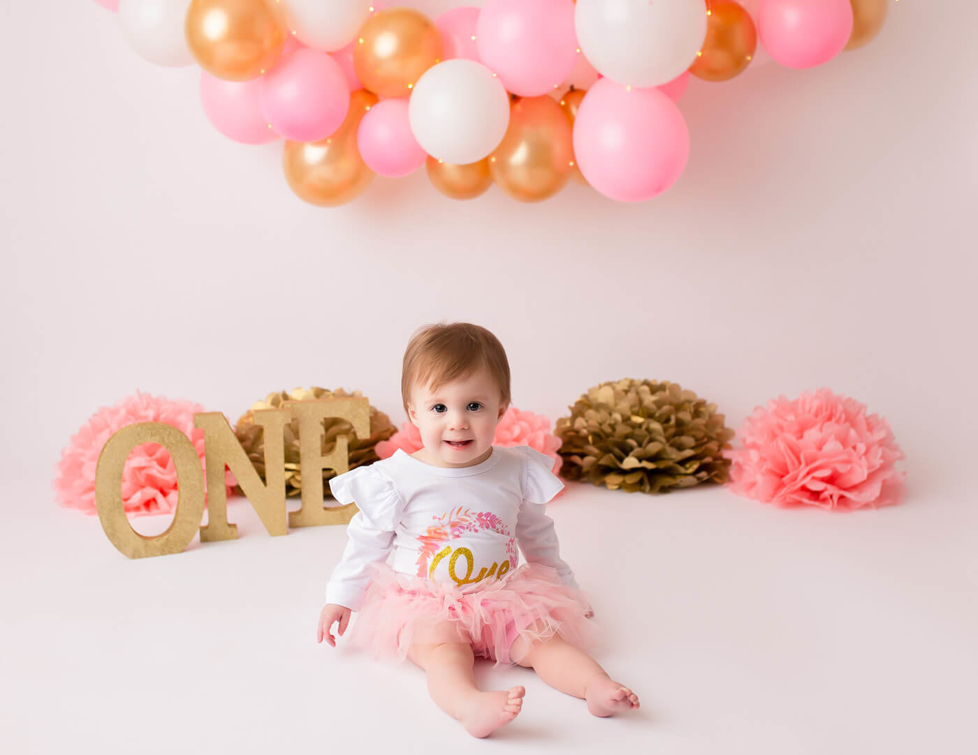 Sweet one year old at her cake smash in our studio in Rochester, NY.