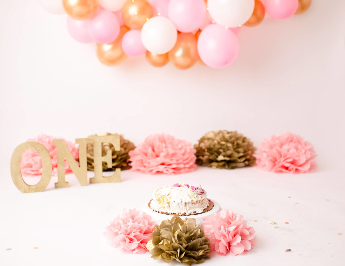 Pink and gold cake smash in our Rochester, NY studio.