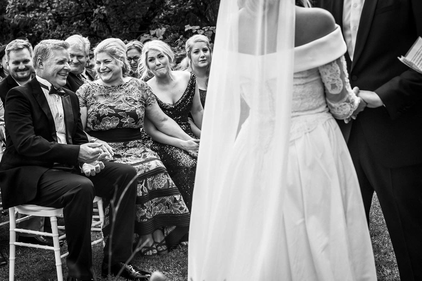 Family laughing and smiling during outdoor wedding ceremony