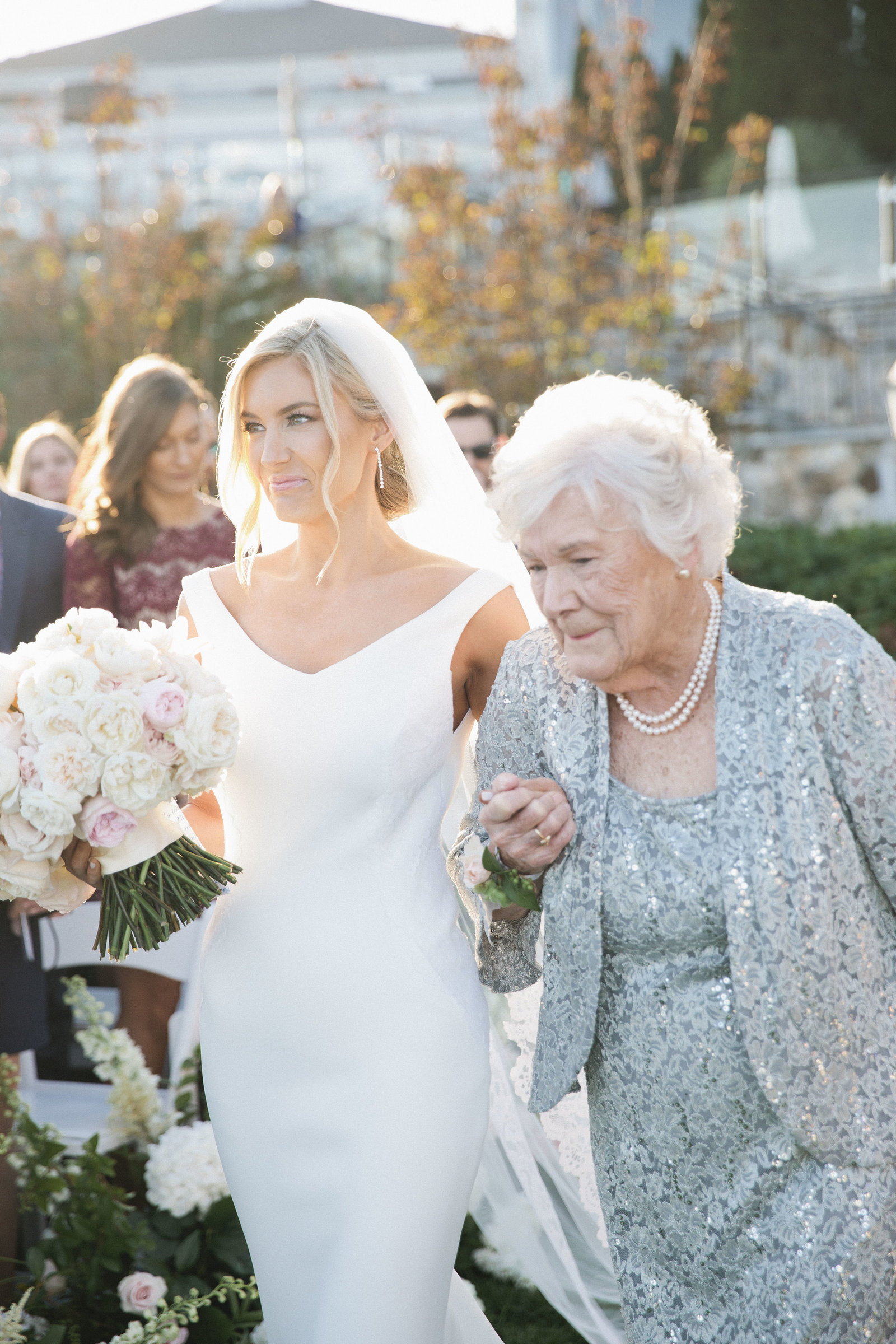 Whitney Bischoff and her Grandmother walking down the aisle together at Wequassett Resort