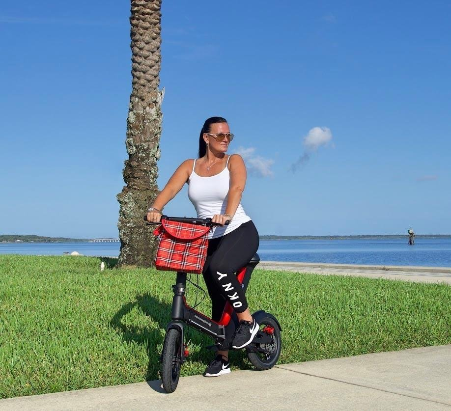 Lady riding Red Go-Bike M3 at the beach; V&D Electric Bikes