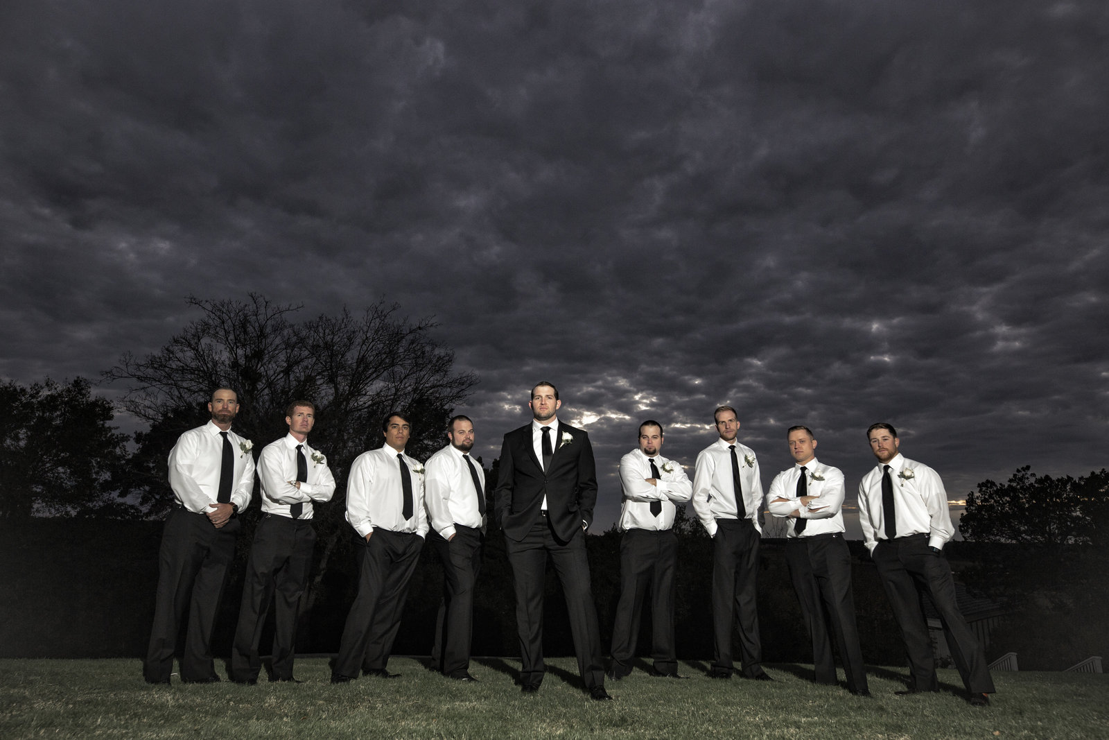 epic groom and groomsmen photo with epic clouds