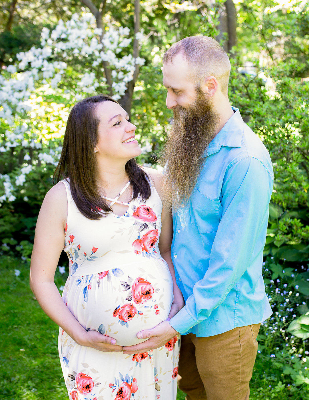 Posed maternity couple at the Sunken Gardens Highland Park in Rochester NY.