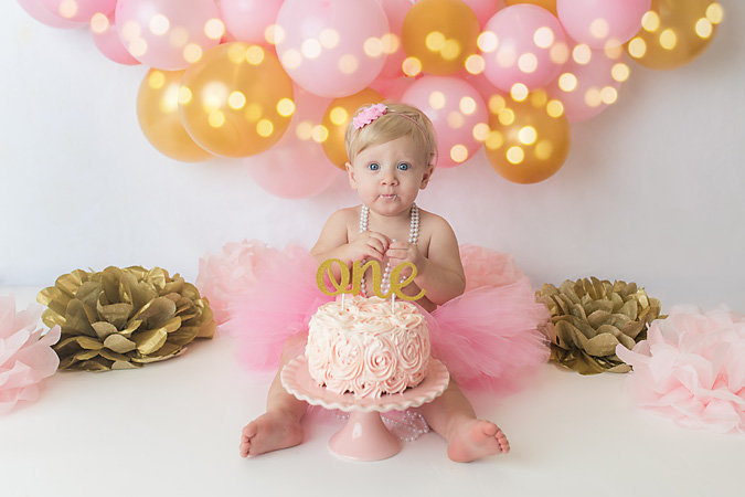 pink and gold cake smash for navarre one year old