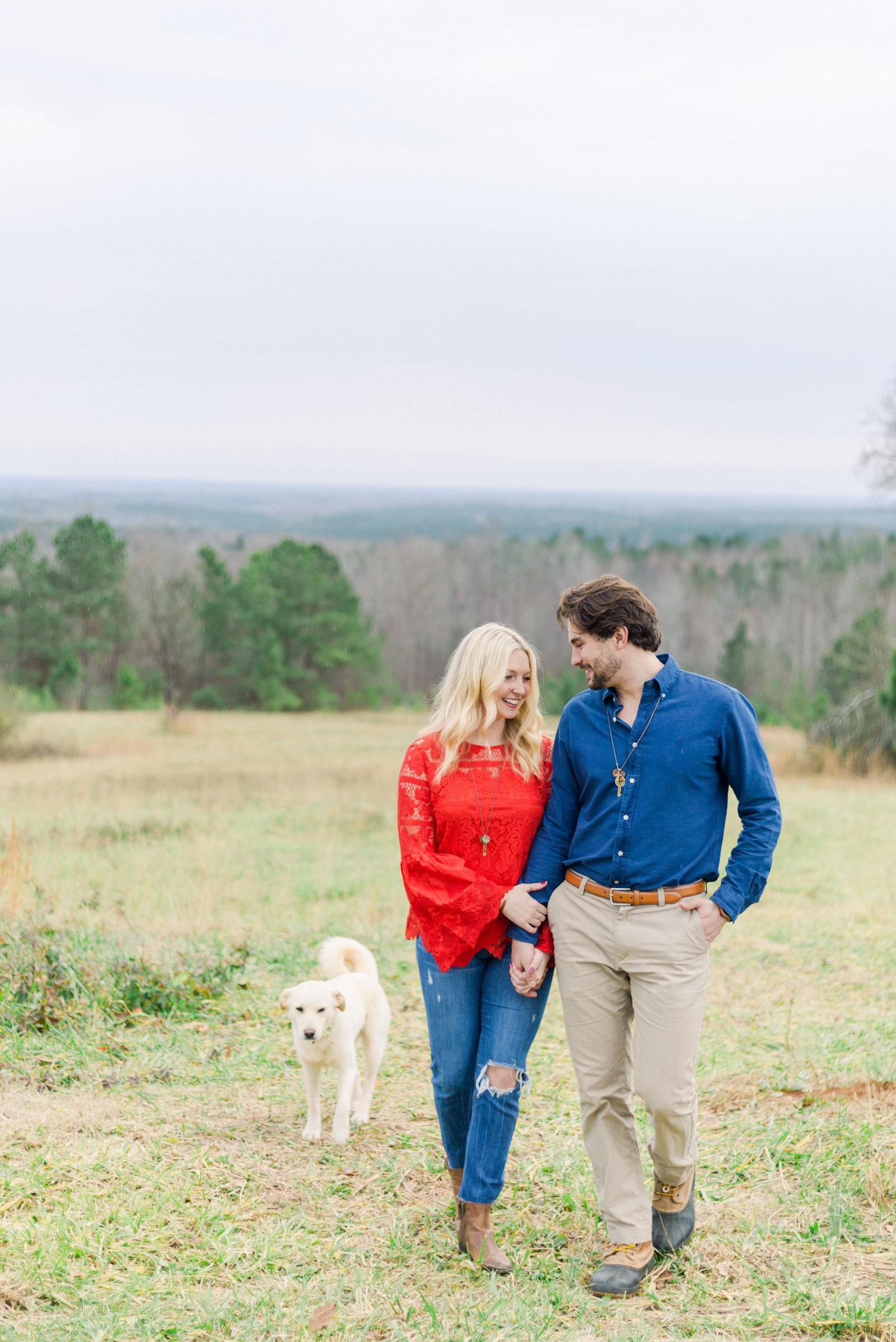 Newly engaged couple and their puppy  captured by Staci Addison Photography